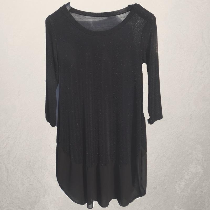 zwarte jurk met lichte glinstering