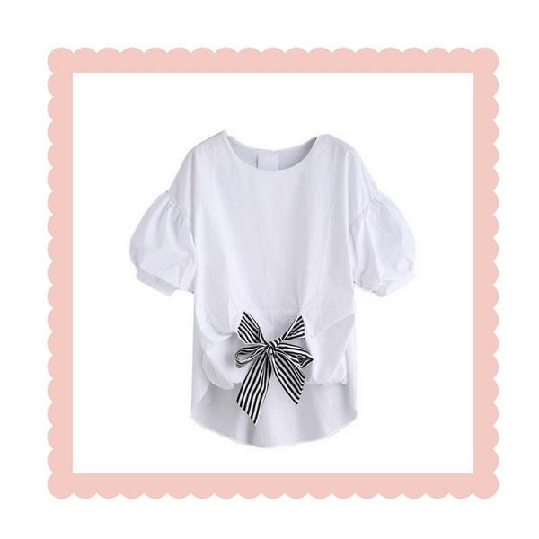 witte blouse met pofmouwtjes en zwart witte strik