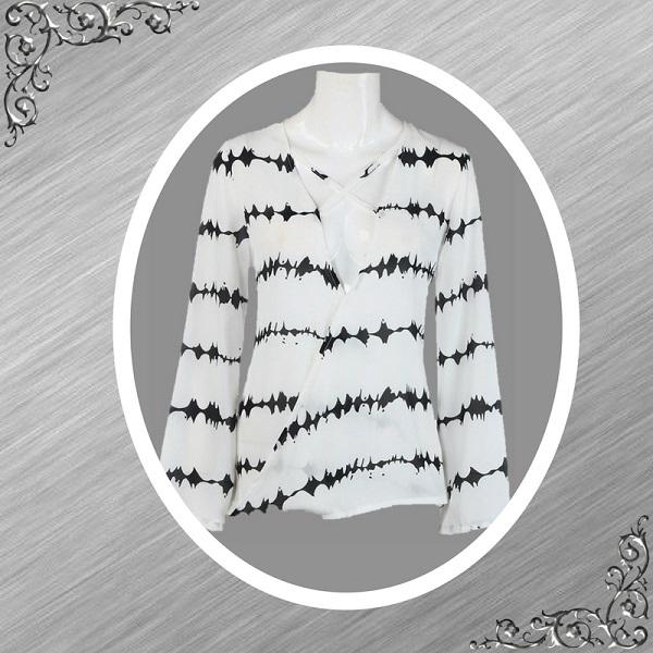 Blouse wit met batik print