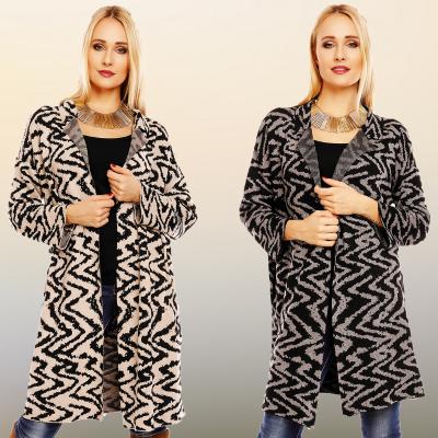 half lang vest in de kleur beige of grijs met zwarte print